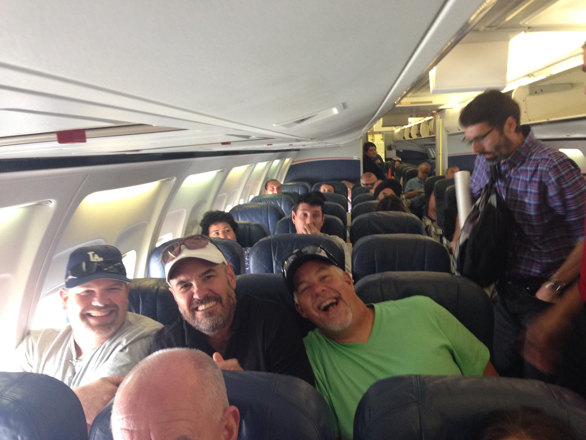 Brandt, Emmett, and Scott Squeeze into Small Plane Seat