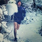 David Petersen running in the snow