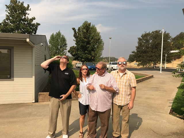 North Valley High School Staff taking a look at the eclipse