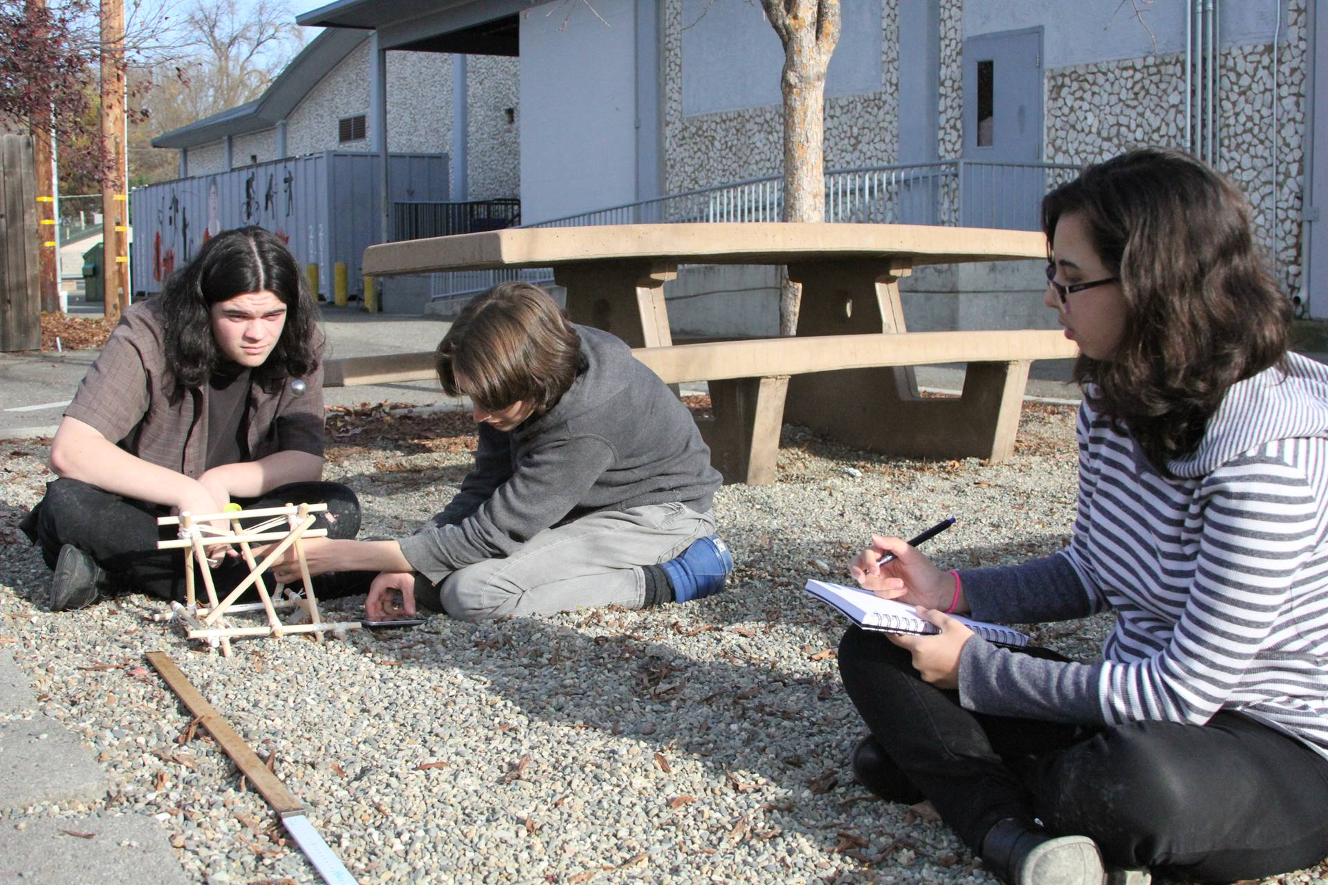 Physics students test catapults.