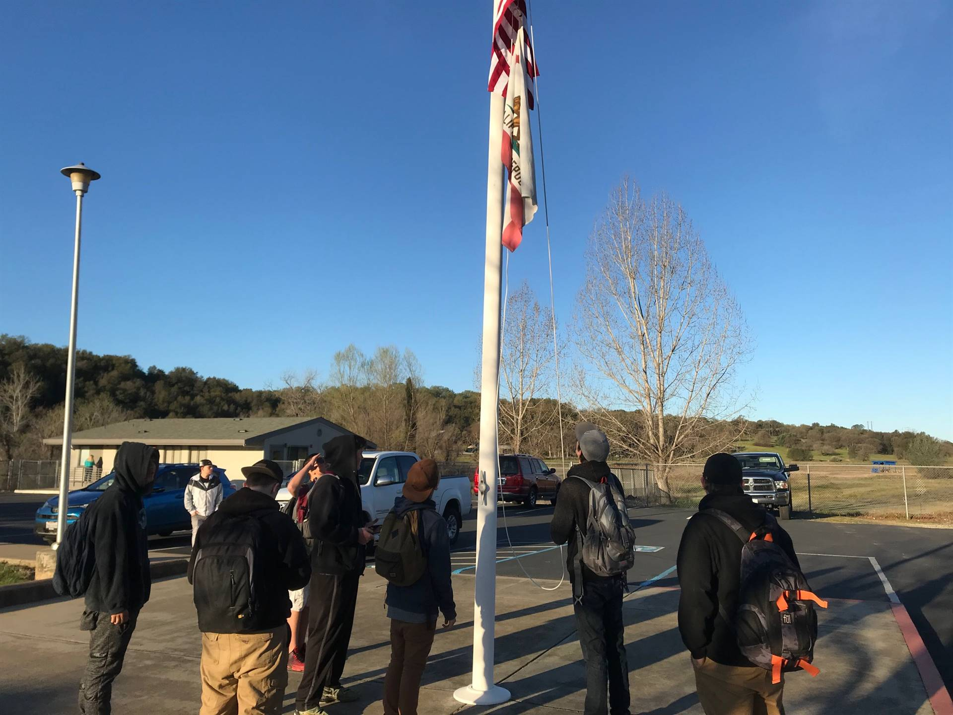 photo of students raising flag